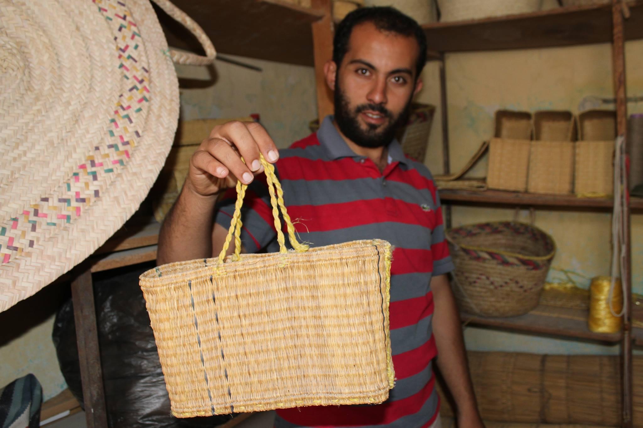 A craftsman making beautiful baskets from wetland plants. Photo: H. Naoufel
